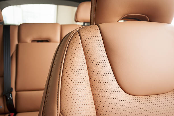leather car seats  detail with focus on stitch - car interior stock photos and pictures