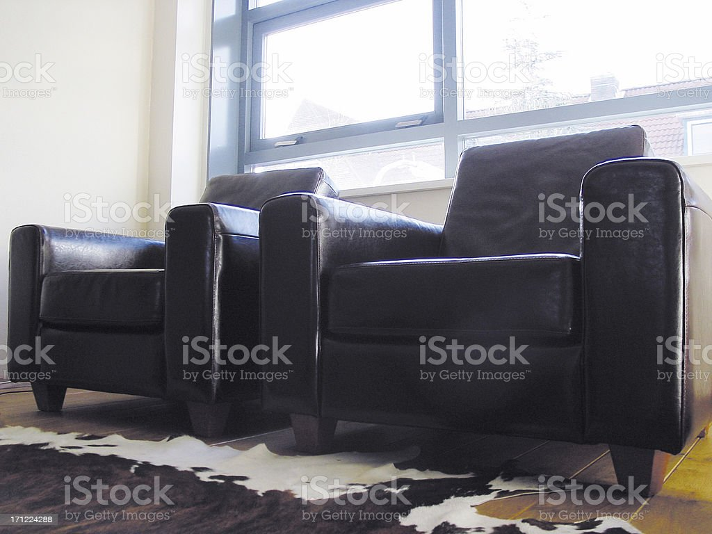 leather chairs in the sun royalty-free stock photo
