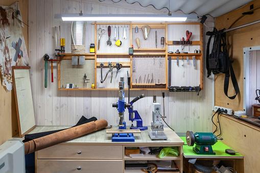 Photo of leather craft workshop interior.