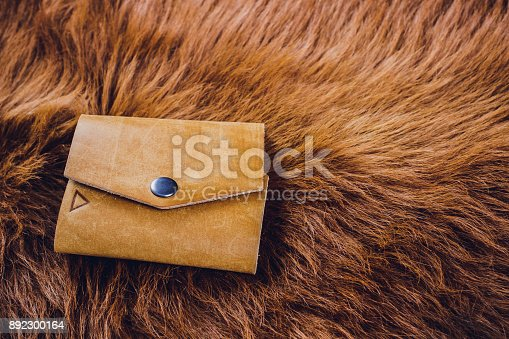 istock leather craftsman working making products at table in workshop studio 892300164