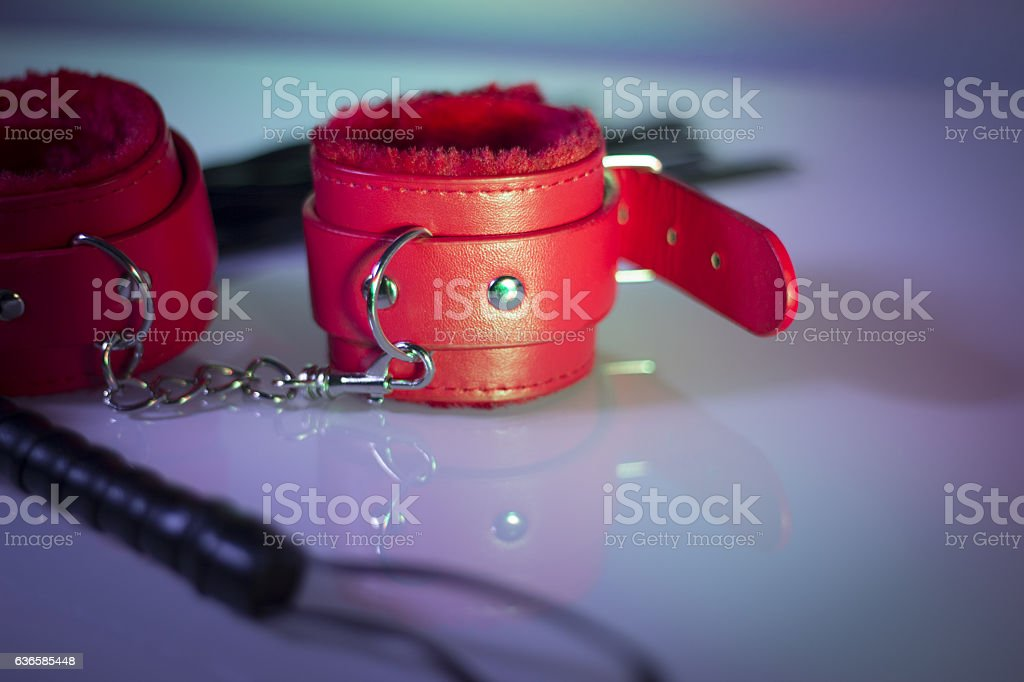 Leather cuffs for hands and legs for erotic games stock photo