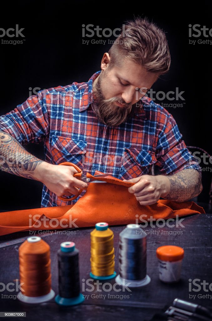 Leather Currier producing leather goods stock photo
