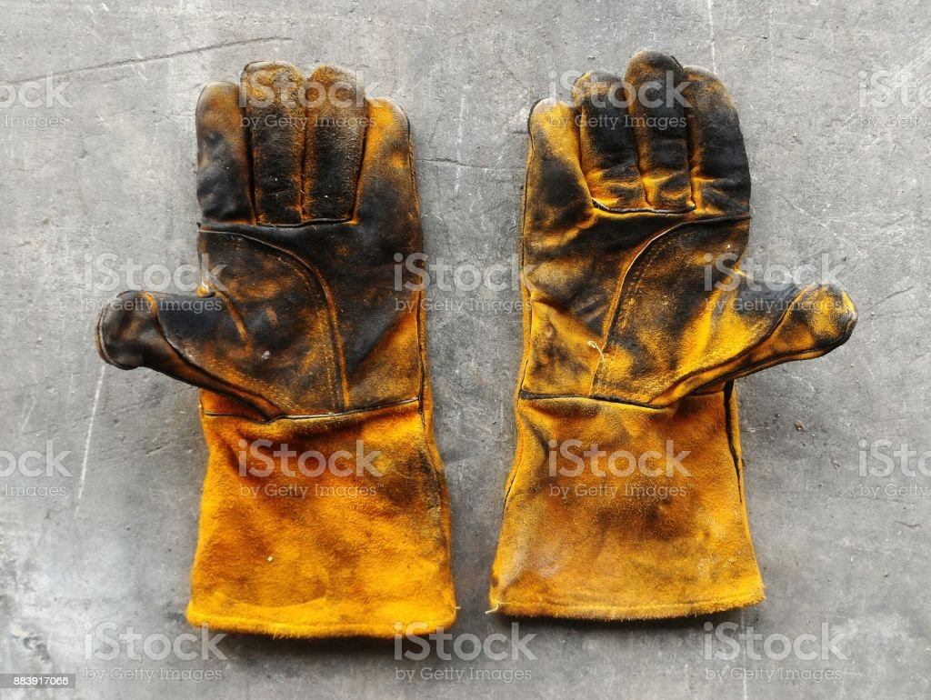 leather glove after work hard on dirty cement ground – zdjęcie