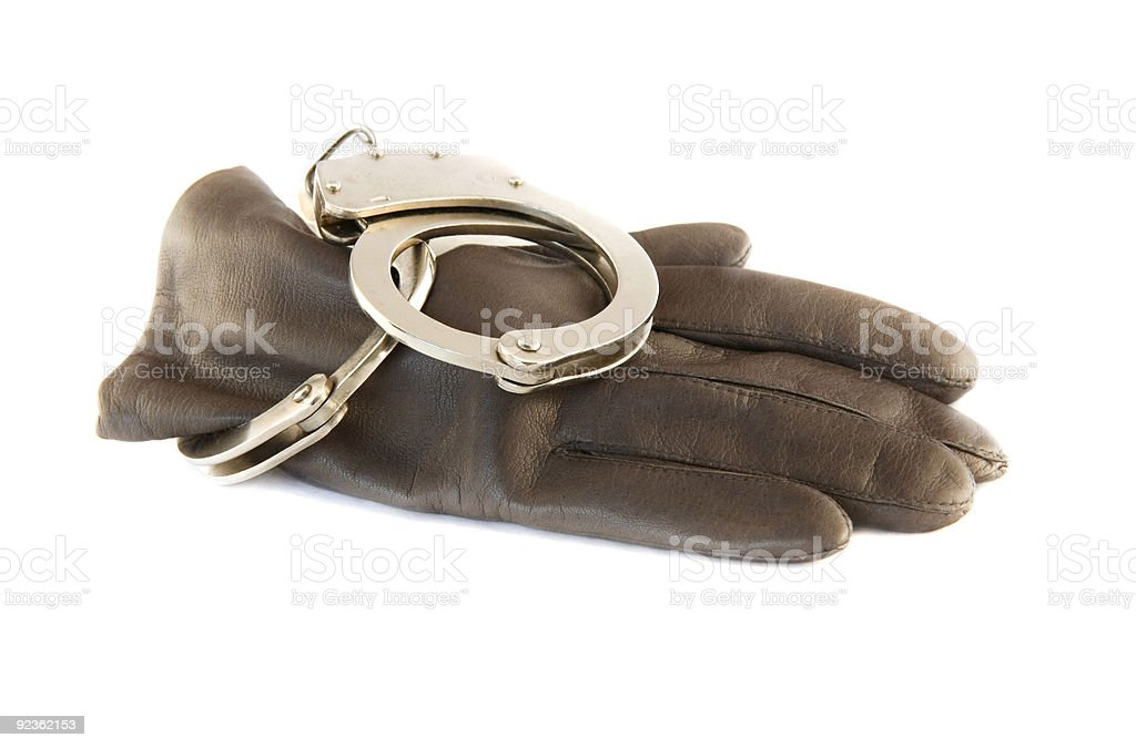 leather gloves and handcuffs royalty-free stock photo