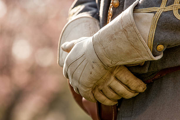 Leather Gloves A reenactment in Virginia. A close up of the hands of an actor, showing vintage attire. Leather gloves cover the actors hands and no face is shown. american civil war stock pictures, royalty-free photos & images