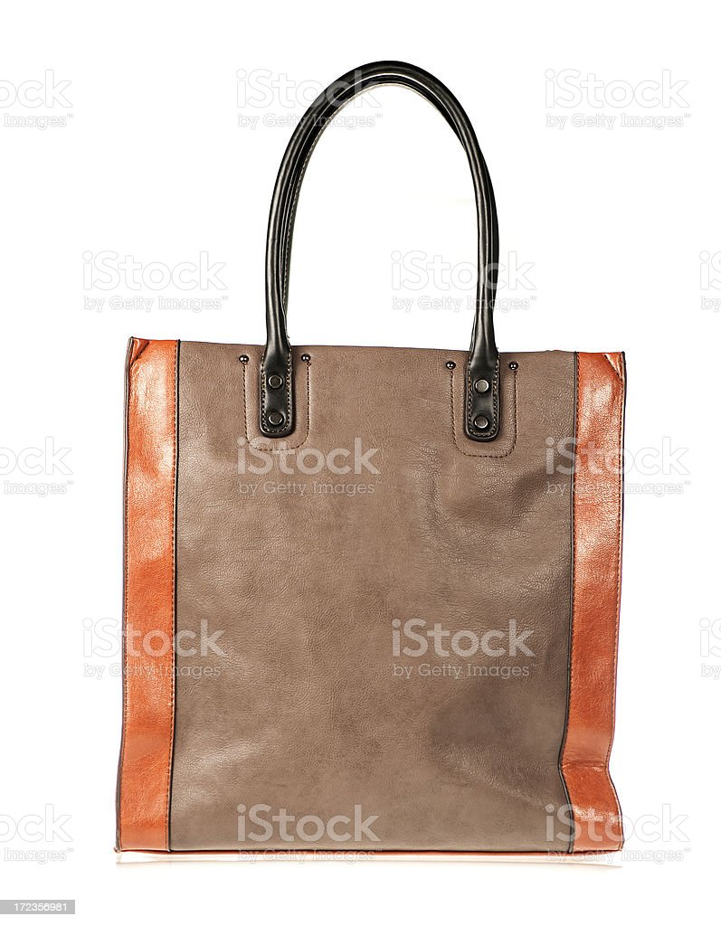 Leather handbag in orange and brown royalty-free stock photo