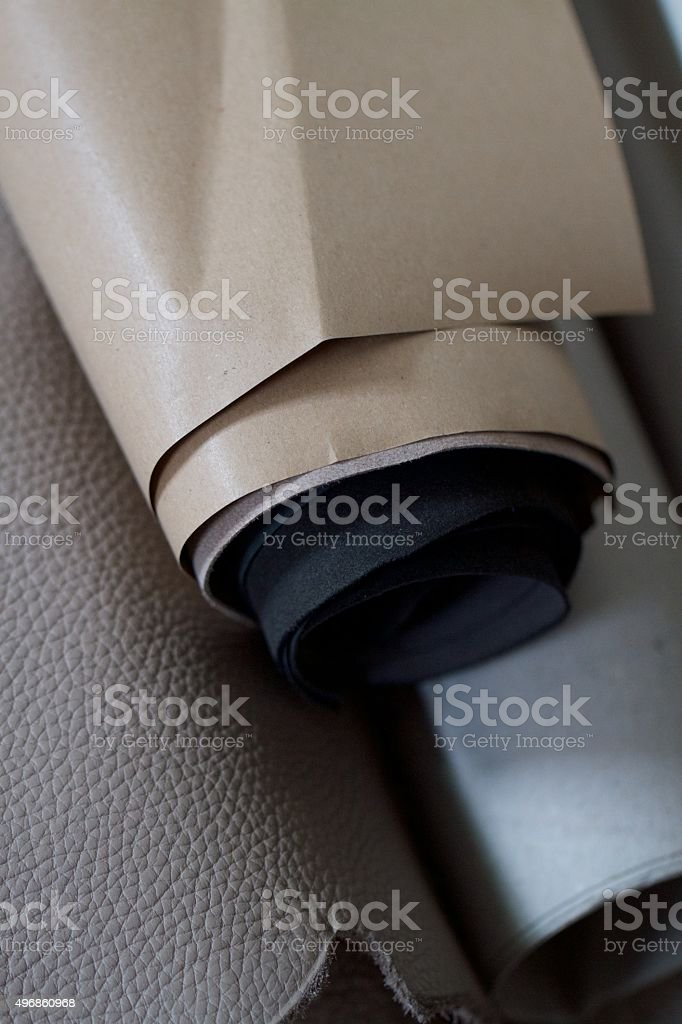 Rolls of stock, calf leather hides
