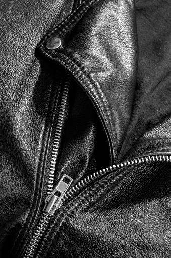 672414164 istock photo leather jacket close up 871414324