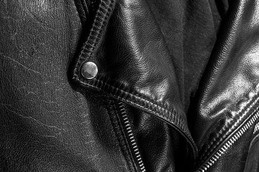 672414164 istock photo leather jacket close up 871414328