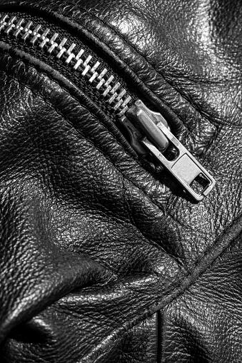 672414164 istock photo leather jacket close up 871414336