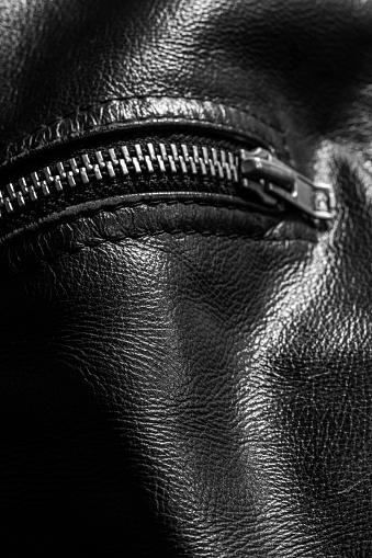 672414164 istock photo leather jacket close up 871414470