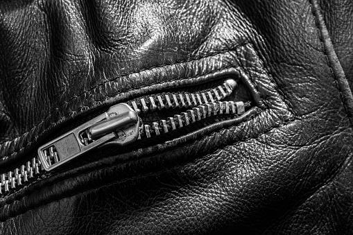 672414164 istock photo leather jacket close up 871414514