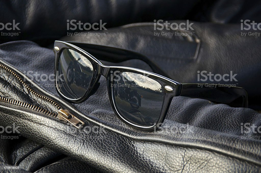leather jacket detail with sunglasses stock photo