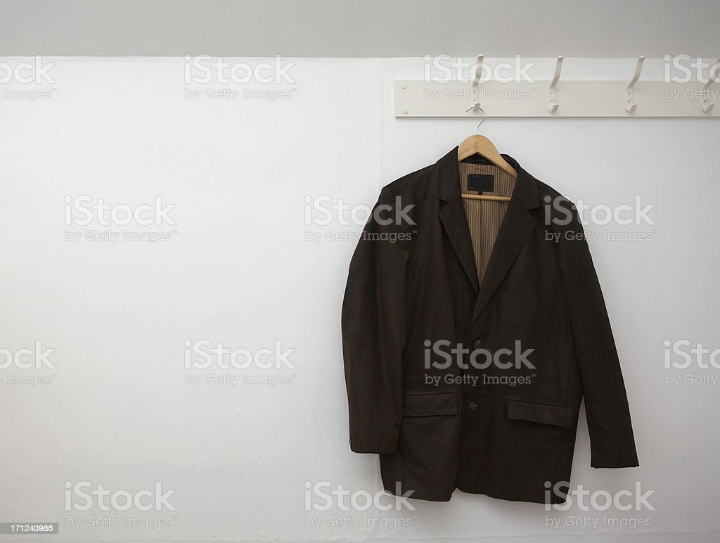Leather jacket hanging on the wall stock photo