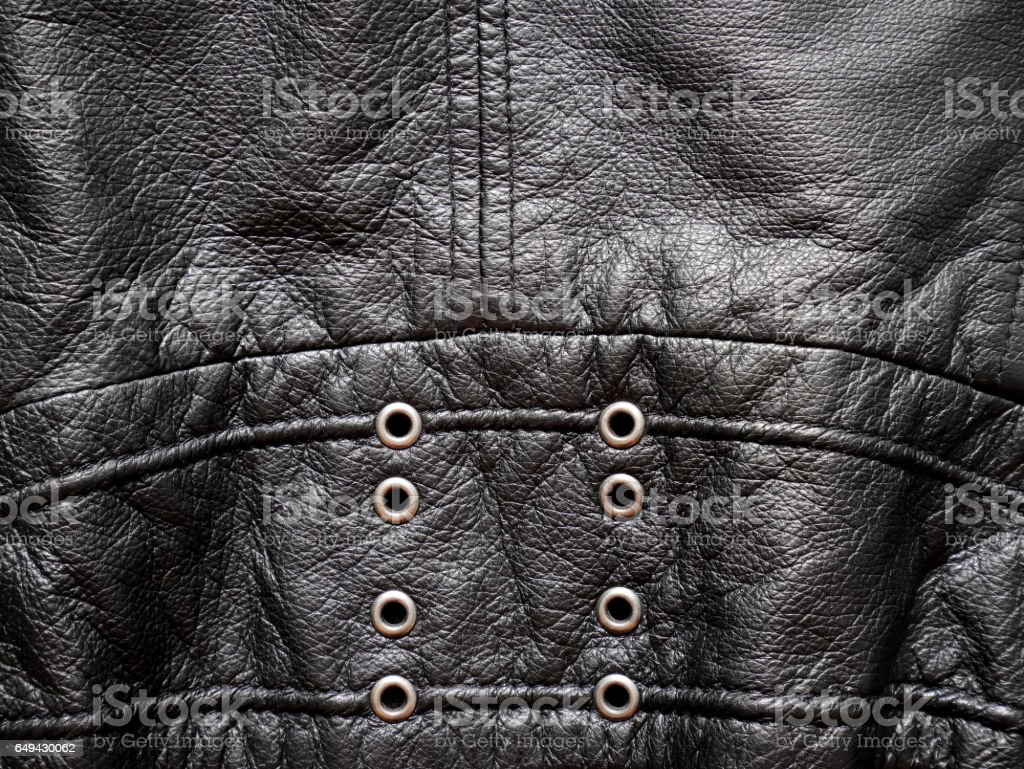 Leather jacket texture with eyelets stock photo