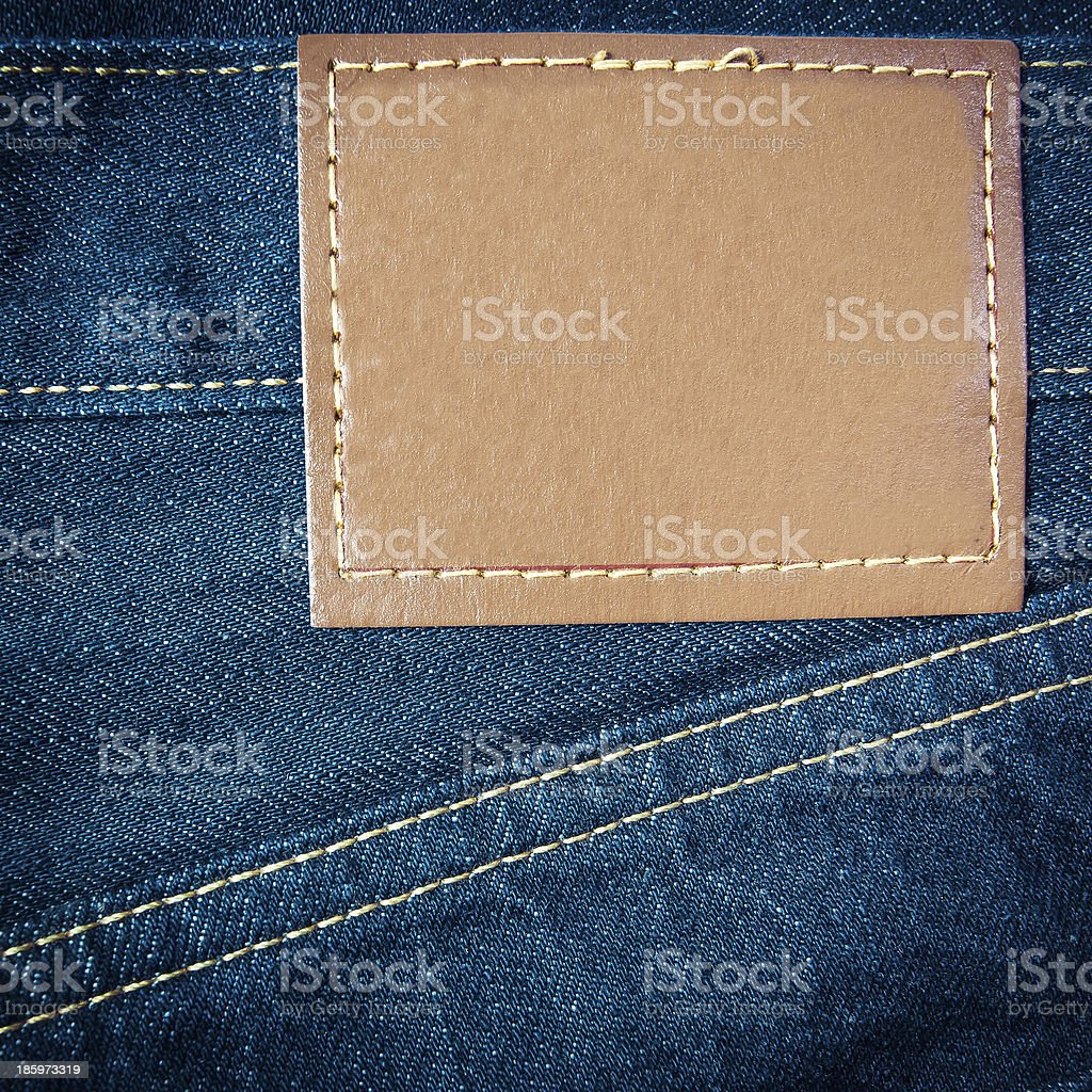 Leather jeans label sewed on jeans. stock photo
