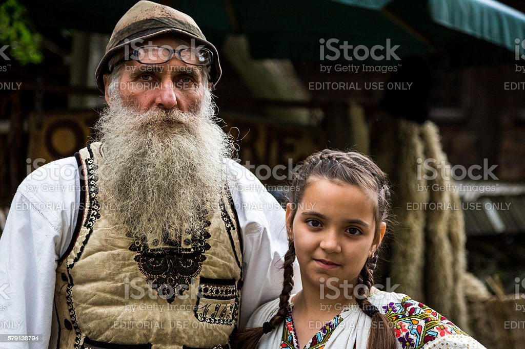 Leather Maker and his Daughter in Traditional Clothing, Bucharest, Romania stock photo