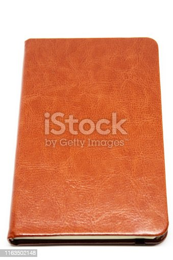 Classic leather notebook close up isolated.