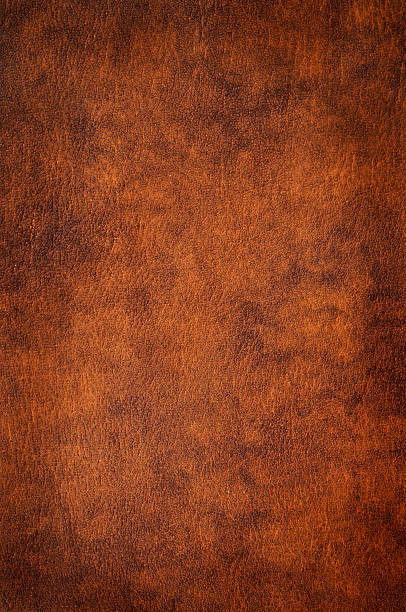 Leather Brown leather texture to serve as background.To see more of my leather textures click the link below: leather stock pictures, royalty-free photos & images