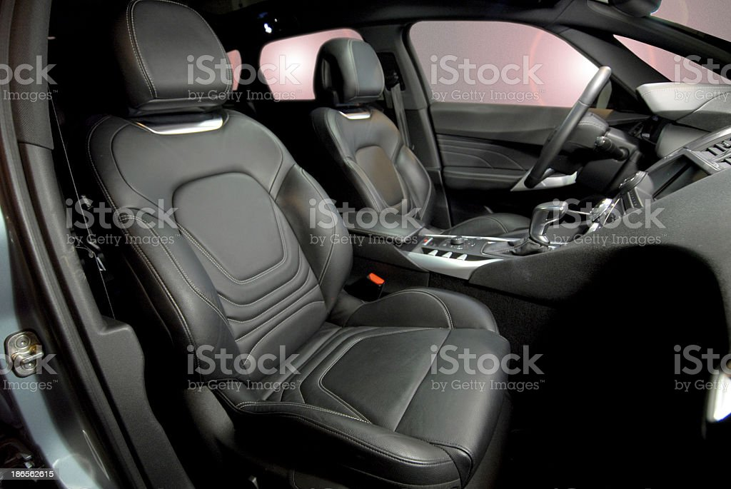 Leather seats for the interior of a black car stock photo