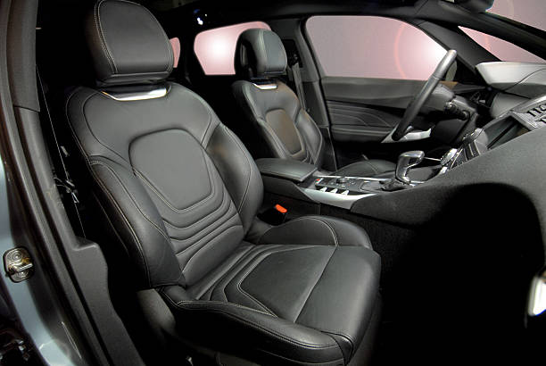 leather seats for the interior of a black car - car interior stock photos and pictures