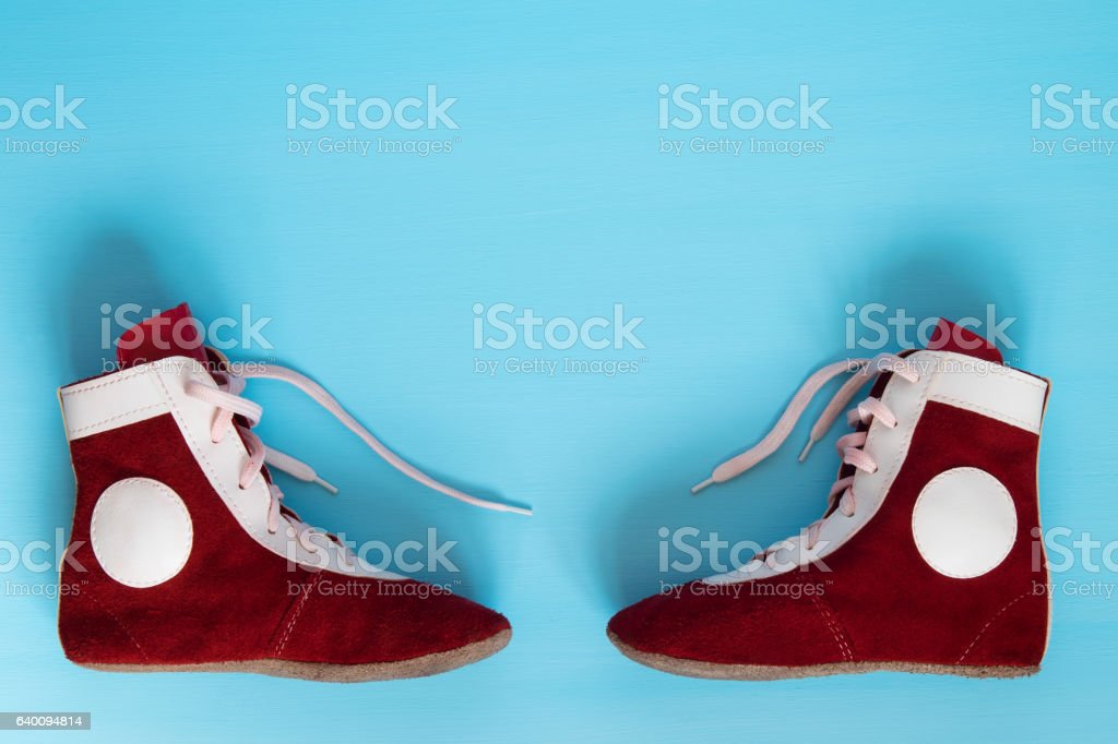 Leather shoes are to fight on a blue background stock photo