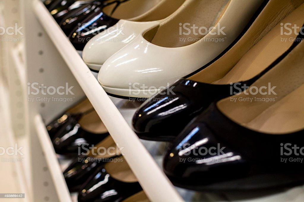 Leather shoes on shelf stock photo