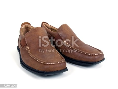 A Pair Of Tan Leather Loafers Isolated On White Background