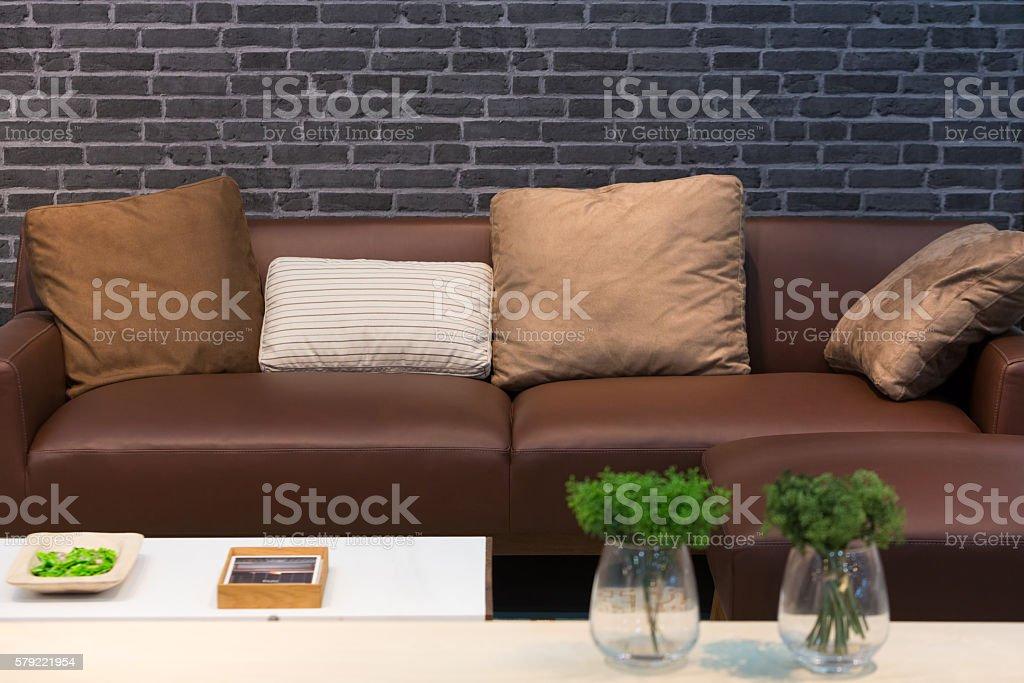 Leather sofa and cushions stock photo