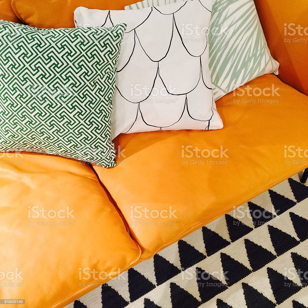 Leather sofa with ornamental cushions stock photo