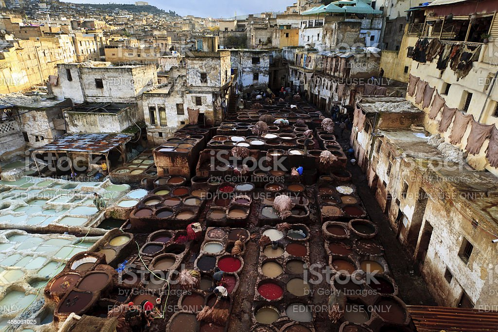 Leather tannery in the middle of residential neighborhood  Fez, Morocco royalty-free stock photo