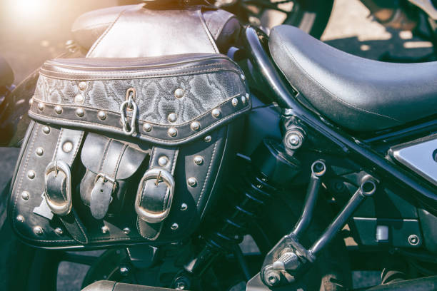 Leather travel bag on a motorcycle. Motorbike parked on a street. Leather travel bag on a motorcycle. Motorbike parked on a street. Freedom and travel concept. three wheel motorcycle stock pictures, royalty-free photos & images