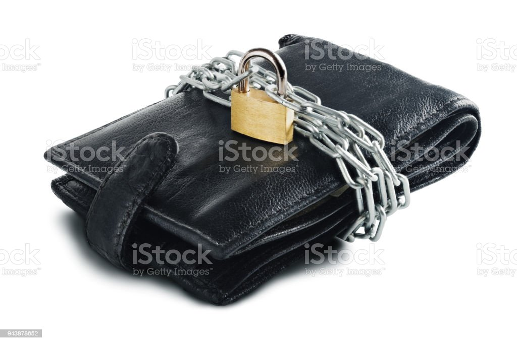 Leather wallet with lock and chain on white isolated background. Concept of protecting electronic money and safety personal finances. Financial  security  in cashless and cash settlements. stock photo