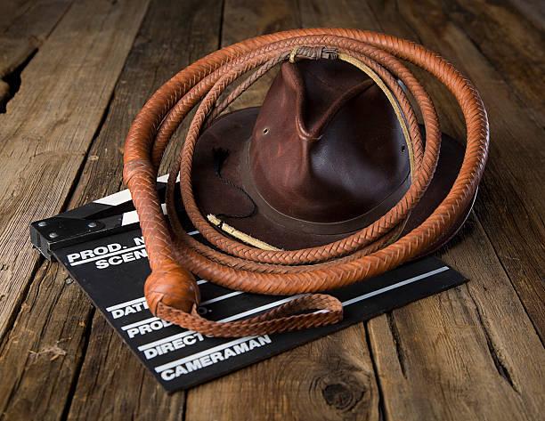 peitsche und mütze aus leder - klappe hut stock-fotos und bilder