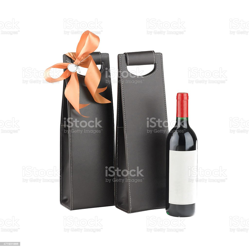 leather wine bags and wine bottle stok fotoğrafı