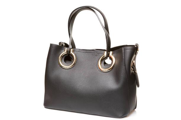 b41ae243fed9d Deri kadın çanta iki uzun kolları, beyaz bir arka plan üzerinde siyah çanta  ile izole