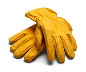 Wearing protective gloves, a woman's hands wash the dishes.