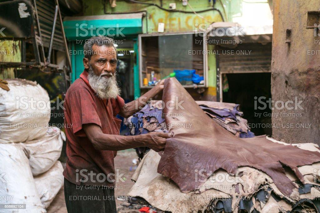 Leather Worker, Dharavi Slum, Mumbai, India stock photo