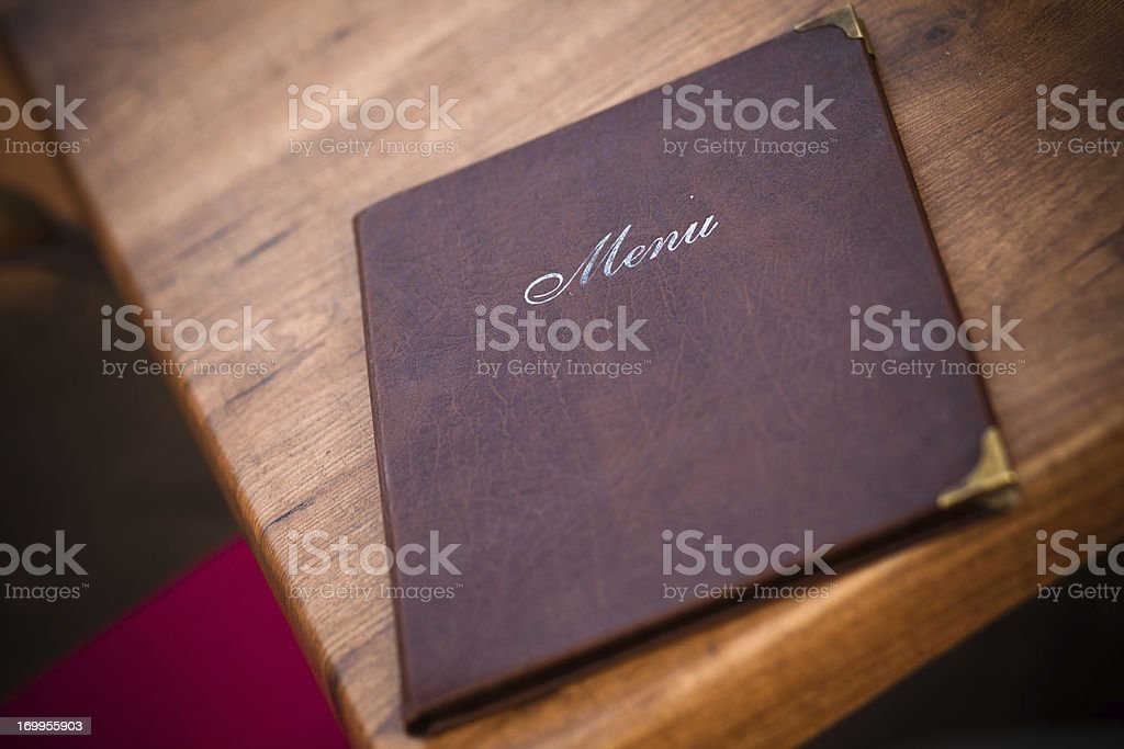 Leather-Bound Menu at European Cafe stock photo