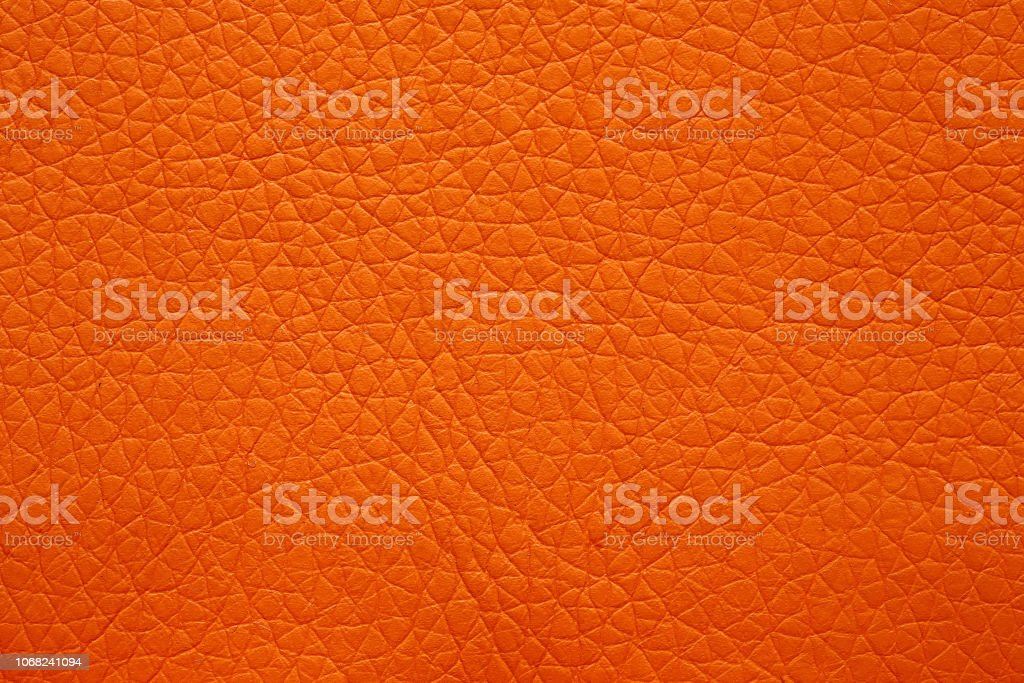 Leatherette texture in magnificent orange colour. Bright orange...