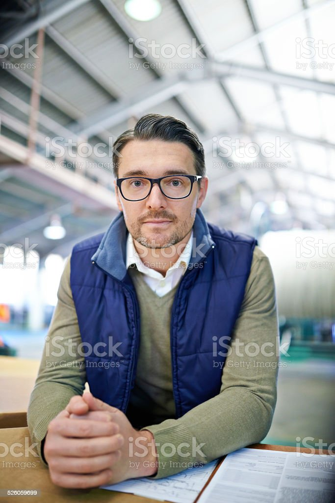 Leave your logistical issues with me Shot of a man working in a large warehouse Adult Stock Photo
