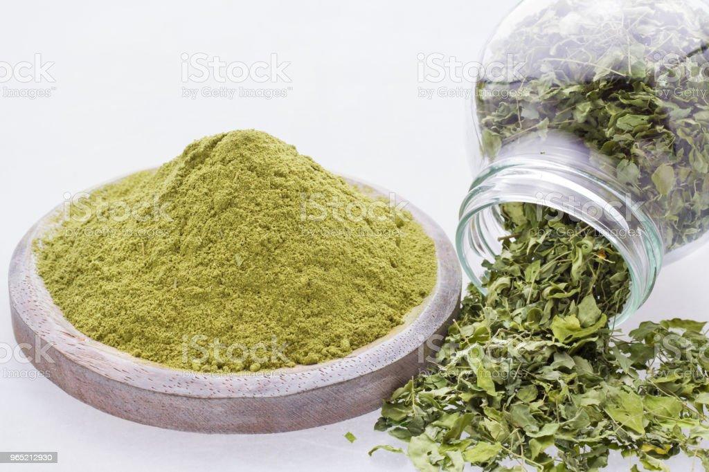 leaves and moringa powder royalty-free stock photo