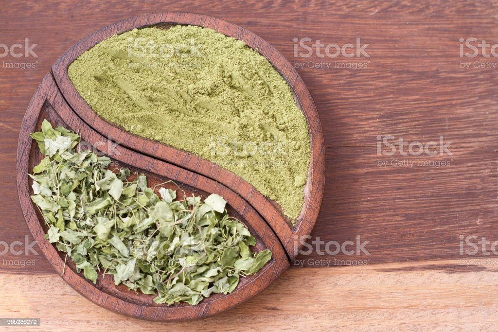 leaves and moringa powder royalty-free stock photo