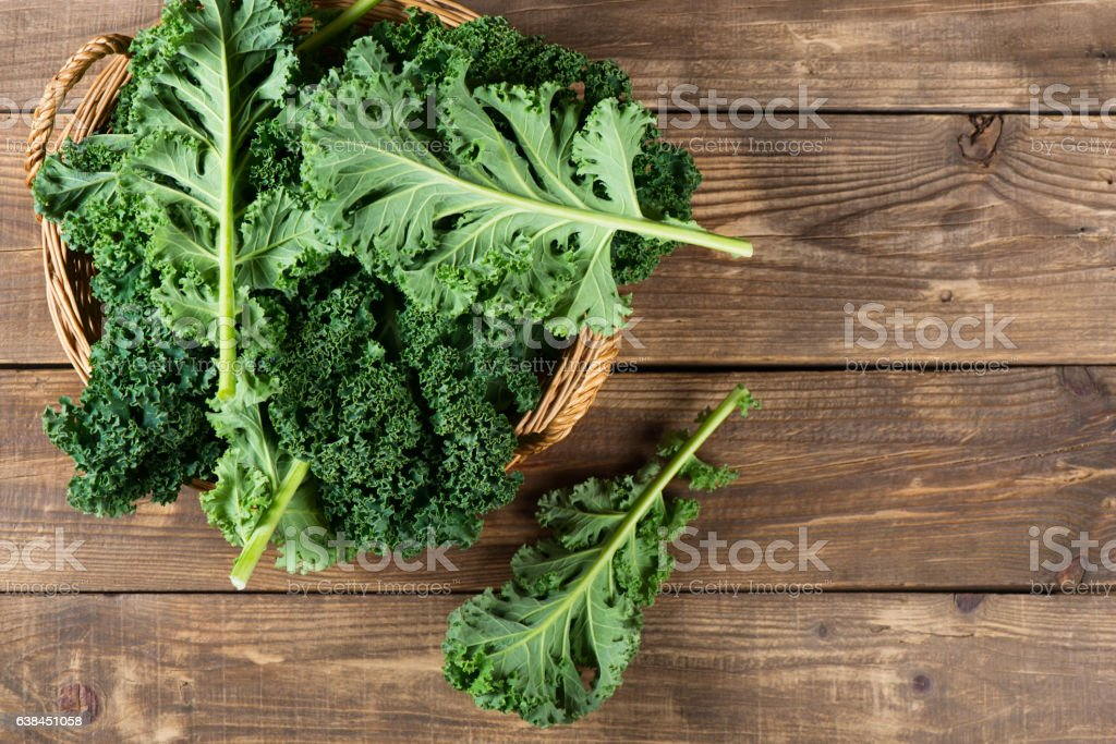 Leaves of  raw kale, above view. stock photo