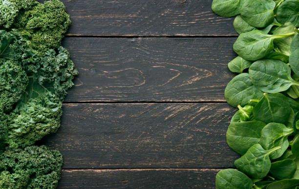 Leaves of raw kaleand spinach, above view stock photo