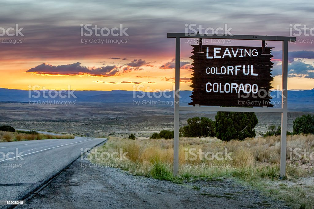 Leaving Colorado Roadsign on a desolate interstate highway. stock photo