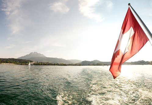 Leaving Lucerne at sunset with a sunset cruise on water switzerland