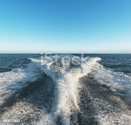 The wake of a ship stretches to the Atlantic horizon on a warm Autumn afternoon.
