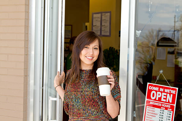 Leaving the coffee shop with recycled cup stock photo