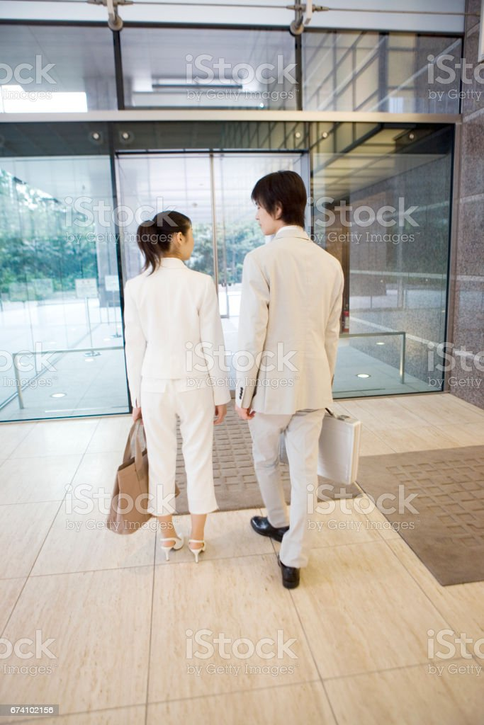 Leaving the company building with colleagues royalty-free stock photo